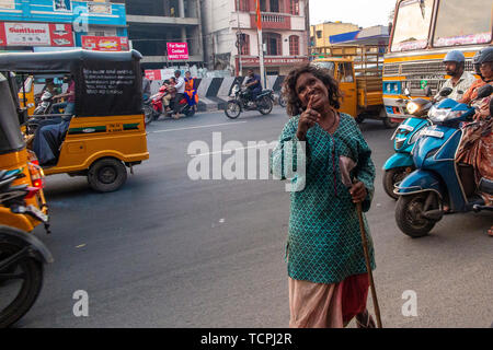 Poverty in Chennai, India, where a lady begs for money in the street - Stock Image