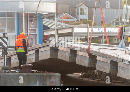 Schull, West Cork, Ireland. 16th Apr, 2019. West Cork Civil Engineering were given the task of refloating the €600,000 Schull pontoon, ready for the season.  The weight of two pieces of the pontoon bolted together proved too much for the crane. Credit: Andy Gibson/Alamy Live News. - Stock Image