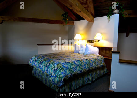 Loft bedroom exposed wooden beams Canadian Princess Fishing Lodge Ucluelet BC - Stock Image