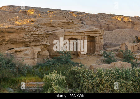 A small temple built into the rocks, located between Edfu and Aswan on the River Nile, Egypt, Africa - Stock Image