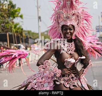 Samba Dancer wearing pink feathers and a silver attire - Stock Image
