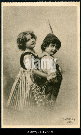 GERMANY - CIRCA 1914: A promotional postcard (Carmol tut wohl) printed in Germany, shows a boy and a girl in traditional - Stock Image