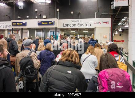 Men women and people at London's Euston station  England UK - Stock Image
