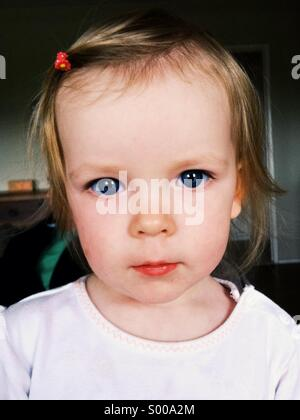 A soulful gaze from a young girl. - Stock Image