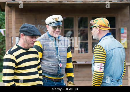 Chichester, West Sussex, UK. 14th Sep, 2013. Goodwood Revival. Goodwood Racing Circuit, West Sussex - Saturday 14th September. Three men dressed as Chino from The Wild One talk following their parade laps of the circuit. Credit:  MeonStock/Alamy Live News - Stock Image