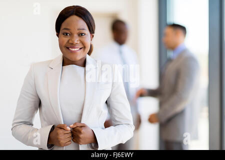 modern African businesswoman in office looking at the camera - Stock Image
