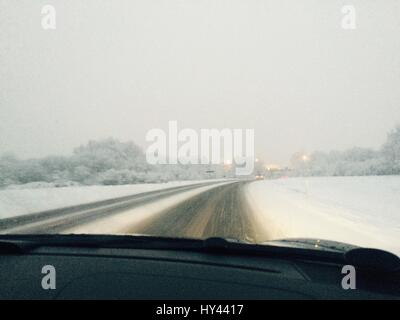 Road Seen Through Car Windshield During Winter - Stock Image