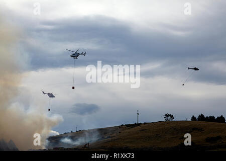 Helicopters fighting fire at Burnside, Dunedin, South Island, New Zealand - Stock Image