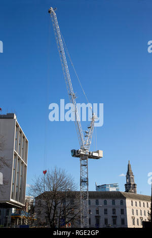 Tower crane in use on a large construction site in Leeds City centre, Yorkshire U.K. - Stock Image