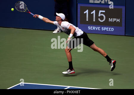 New York, United States. 02nd Sep, 2018. Flushing Meadows, New York - September 2, 2018: US Open Tennis: Kevin Anderson of South Africa reaches wide for a forehand return against Number 9 seed, Dominic Thiem of Austria during their fourth round match at the US Open in Flushing Meadows, New York. Thiem won in straight sets. Credit: Adam Stoltman/Alamy Live News - Stock Image