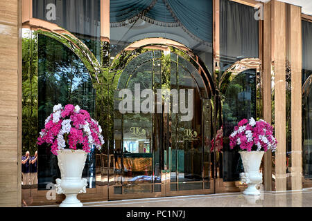 Hotel entrance. Polished copper glass front. Thailand hotels, Southeast Asia - Stock Image