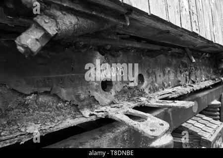 Detail of boiler intake in rusty train car at the abandoned Canfranc International railway station (Canfranc, Pyrenees, Huesca, Aragon,Spain) B&W vers - Stock Image