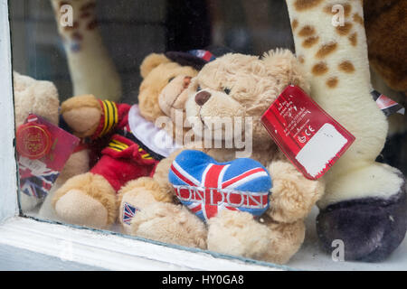 WINDSOR, UK - MARCH 18, 2017: Teddy bears in a souvenir shop window in the popular tourist town on Windsor in March - Stock Image
