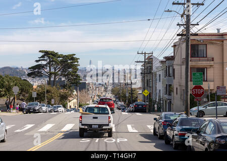 Pickup truck with surfboard on Clement Street, eastward view, San Francisco, California, USA - Stock Image