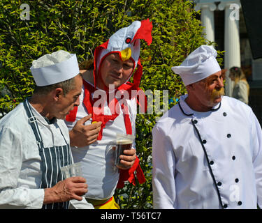 Teams taking part in the annual Good Friday Marbles Competition in fancy dress in Battle Market Square, Battle, East Sussex, UK - Stock Image