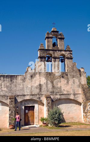 Mission San Juan Capistrano belltower woman leaving office San Antonio Texas tx missions national historical park - Stock Image