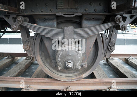 """New York, USA. 31st Mar, 2019. New York, NY.  The wheel of a German National Railroad freight car that was installed on the plaza in front of the Museum of Jewish Heritage in Battery Park City, Manhattan, New York on the morning of March 31 as part of the museum's upcoming exhibition, """"Auschwitz. Not long ago. Not far away."""" This freight car, which would have been packed with 80 to 100 people, was one of many that the Nazis employed to transport people — most of them, Jews — to Auschwitz to be killed. Credit: Terese Loeb Kreuzer/Alamy Live News - Stock Image"""