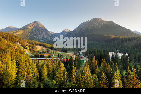 Strbske Pleso in High Tatras Mountains with rocks lying on the grass in foreground - Stock Image