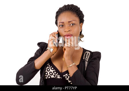 Young businesswoman attentive to the phone. - Stock Image