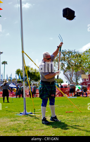Sheaf Toss at the Scottish Festival Orange County Fairgrounds Costa Mesa, California. - Stock Image