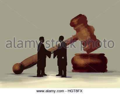 Barristers shaking hands in front of large gavel - Stock Image
