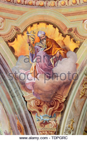 COMO, ITALY - MAY 8, 2015: The fresco of St. Ambrose doctor of the west Church in church Santuario del Santissimo Crocifisso by Gersam Turri (1927-192 - Stock Image