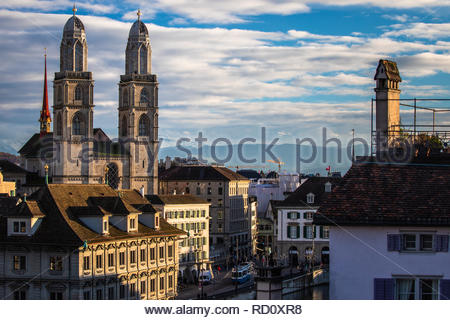 Zurich, Switzerland - view of the Grossmunster church with beautiful mountains in the background - Stock Image