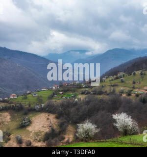 Small mountain Village on a Cloudy spring day - Stock Image