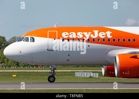 Easyjet Airbus A320 NEO aircraft, registration G-UZHJ, preparing for take off from Manchester Airport, England. - Stock Image