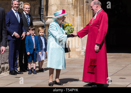 Windsor, UK. 21st April 2019. The Queen shakes hands with the Dean of Windsor, the Rt Revd David Conner KCVO, following the Easter Sunday service at St George's Chapel in Windsor Castle. Credit: Mark Kerrison/Alamy Live News - Stock Image