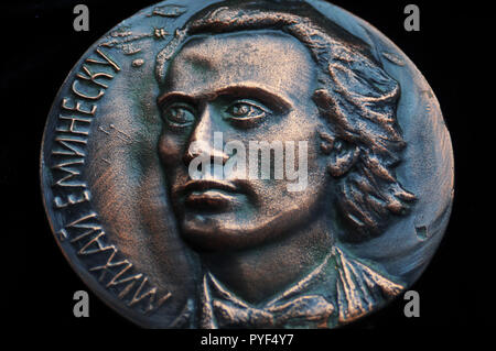 Rare bronze medal of Romanian national poet, Mihai Eminescu, created in 1989 in Moldavian Soviet Socialist Republic, now Moldova - Stock Image