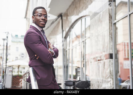 Happy smile of a successful African American businessman in a suit - Stock Image