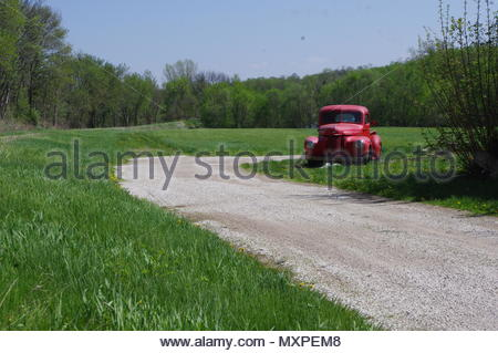 Old pickup truck parked along gravel road, central USA - Stock Image