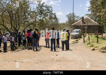 Tourists and localls waiting at the entrance of Ol Njorowa gorge, Hells Gate National Park, Kenya - Stock Image