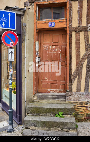 A very crooked wooden door in the city of Rennes the captial of Brittany - Stock Image