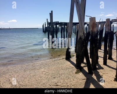 old ruined dock on the beach in Provincetown - Stock Image