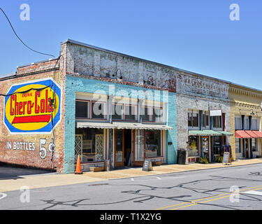 Small town USA stores, shops or storefronts with painted advertising on the building in Alexander City Alabama, USA. - Stock Image