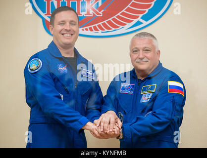 Expedition 51 Flight Engineer Jack Fischer of NASA, left, poses for a photo with Soyuz Commander Fyodor Yurchikhin - Stock Image