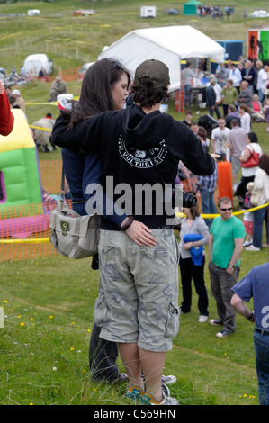 Young couple arm in arm at a fete - Stock Image