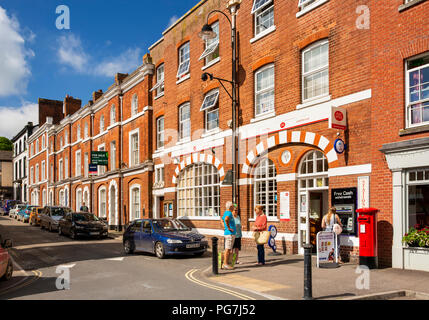 UK, England, Devon, Crediton, Market Street, customers outside town Post Office in Edwardian building - Stock Image