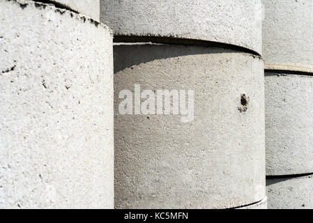 Abstract image of concrete cylindrical tubing used for cesspits and water access points - Stock Image
