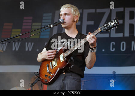 Cai Burns of Kagoule playing his Yamaha guitar on stage at a live music festival. Kagoule are an alternative rock band from Nottingham, UK. - Stock Image