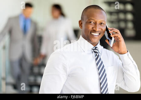 professional African business executive talking on mobile phone - Stock Image