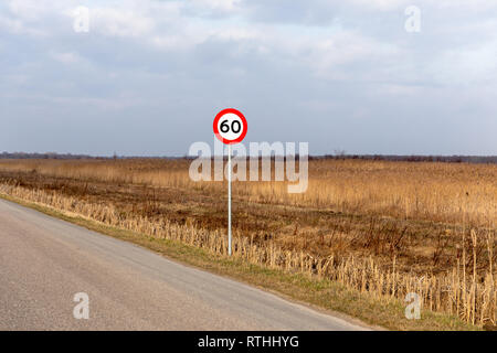 60 km/h speed limit sign by a road in the countryside, Lille Vildmose, Denmark - Stock Image