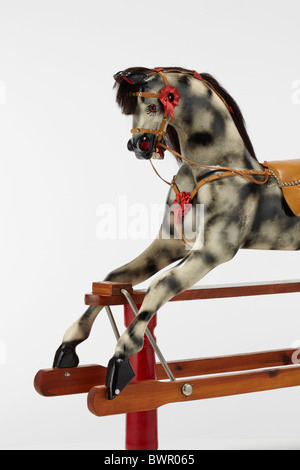 Traditional Rocking Horse on a Wooden Frame - Stock Image
