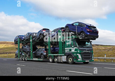 Woodside Motorfreight Limited car transporter HGV. M6 Motorway, Southbound, Shap, Cumbria, England, United Kingdom, Europe. - Stock Image