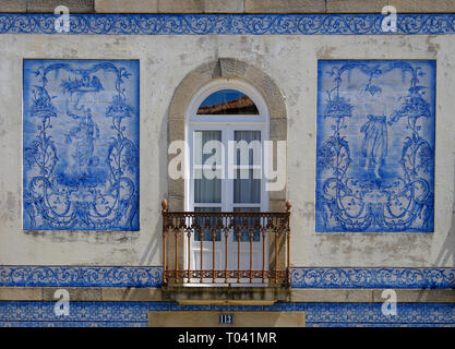 Azulejos (blue tiles)  facade of house. View of top level design of ladies.  Aveiro, Portugal, - Stock Image