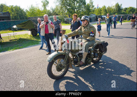 ENSCHEDE, THE NETHERLANDS - 01 SEPT, 2018: A motorcycle passing by during a military army show. - Stock Image