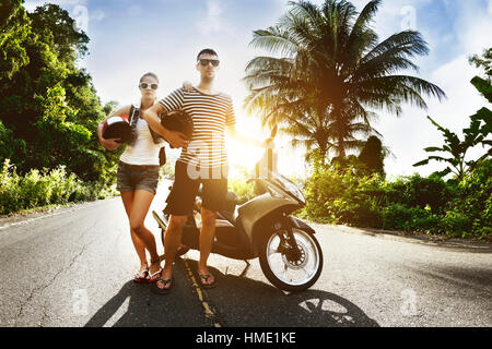 Couple man woman motorcycle sunset road - Stock Image