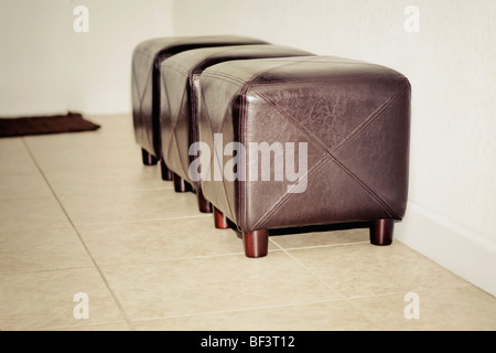 Three ottomans in a living room - Stock Image